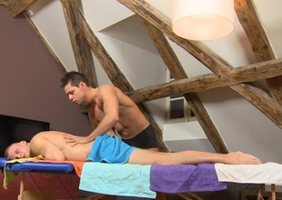 Male masseur is delighting a bulky gay bear