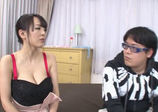 Very busty Asian babe jerks a guy off nearby her big melons