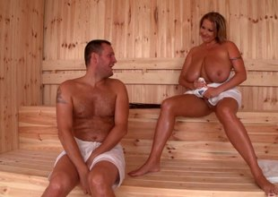 Guy fucks a MILF with monster pair in the steam room