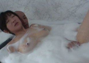 Sizzling hot and horny Japanese girl in the bathtub with her bloke