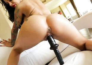 Mistress Angelina Valentine gives a closeup of their way slit as she masturbates
