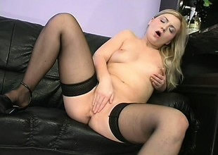 Appealing young girl moorland stockings is rubbing her precious flytrap