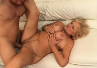 Big-busted blonde granny gets fucked hard and takes a grand millstone on her face