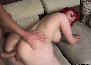 Enchanting milky-skinned red-haired bitch is feeding superior to before throbbing cock