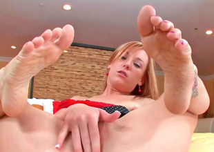 Cute kirmess Dani massages a hard cock with her feet