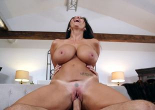 A bimbo with huge special is to the air, getting her cunt fucked
