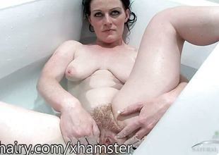 Andrea Foster is hairy plus in the tub for a shrug off dismiss