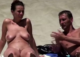 Well done brunette pet on the nudist beach sunbathing