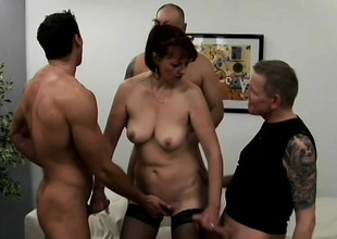 Lustful mature lady has four young studs covering her characteristic with jizz