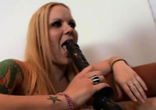 Tattooed redhead with sexy long paws Kendra fucks a huge baleful utilize