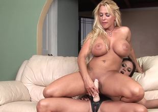 Two curvy lesbian bitches are cautious of big-busted hot toying session