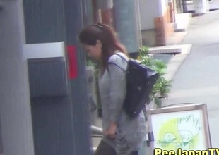 Asian babe leaves piss inlet