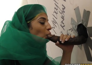 Nadia Ali having fun with black load of shit in a gloryhole