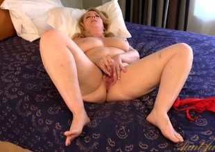 Curvy old lady makes her pussy wet with a vibrator