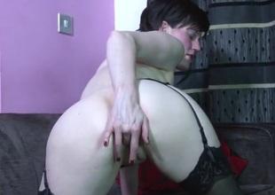 Cute solo milf in stockings rubs her wet cunt