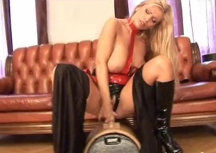 Sex-mad fair-haired newborn in leather toy gender her pussy