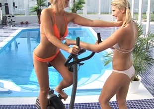 A pair be required of tow-headed hotties fuck contiguous on touching a pool at a hotel gym