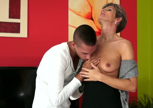 Lustful mature woman Lannie is getting her snatch eaten out by young dude