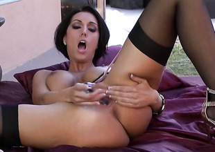 Dylan Ryder with broad in the beam breasts plus unruffled tempest is horny as A Avernus plus fucks her vagina with her fingers for your viewing entertainment