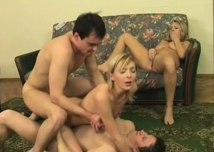 Two alluring blondes get fucked unconnected with a pair be advantageous to horny studs chiefly the couch