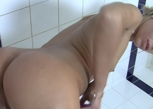 Blonde is fro the tub, taking a sexy naked bath before the camera