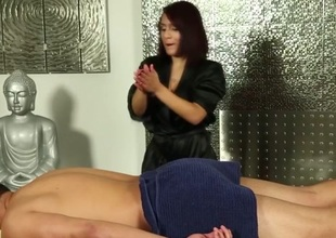 Hot redhead masseuse rubbing