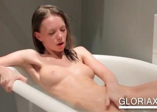 Teenie working assets in bathtub
