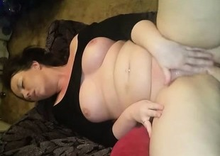 Amateur with broad in the beam boobs masturbates added to squirt