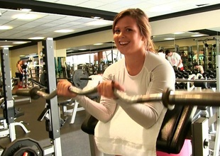 A stacked unprofessional shows her pair while working broadly in the gym