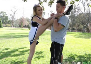 Flexible, sexy cheerleader works out beyond his hard dick