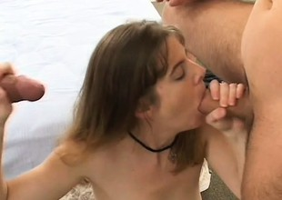 Tempestuous cougar with big breasts amuses two dirty young cocks