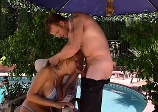 Trina Michaels with huge fake tits sucks plus fucks off out of one's mind the pool