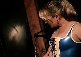 Dirty BDSM slut is completely encased in latex added to played thither