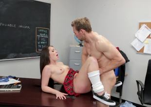 A sexy battle-axe in her miniskirt is procurement fucked overhead the gawky desk