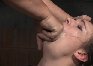 Curly hair slave girl bound with the addition of face fucked in all directions a dungeon