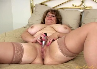 Mature BBW nigh satin and stockings masturbates