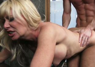 Well-endowed horny voluptuous blonde MILF gives sloppy BJ and gets nailed hard