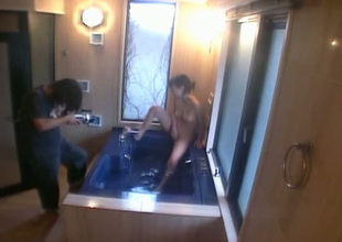 Backstage video of masturbating on every side rub-down the bath tub Japanese girlie