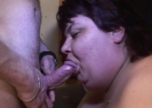 Big mature slut eating on a hard cock