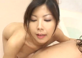Playful Japanese whore rubbing her pussy take dude's body