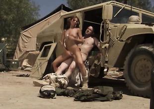 Soldier in uniform is bonking a girl