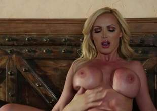 Hot bodied MILF beauteous Nikki Benz give big pretend tits has a wonderful time doing it give younger hard dicked guy. She sucks his pole and then gets her of age pussy penetrated