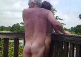Daft adult stiffener has coitus on a bridge in nature