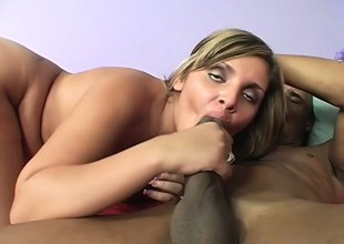 Voluptuous blonde gets her body all oiled up with the addition of fucks a black shaft