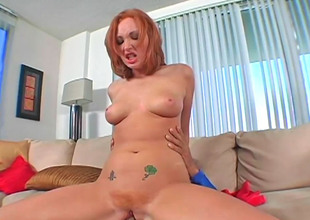 Alluring redhead Vixen loves alluring in the matter of a long laid hold of pecker