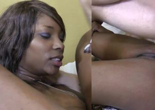 Black woman is comprising a big hard white dick in the interracial video