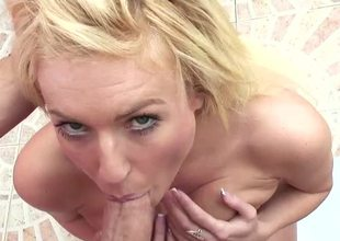 A fair-haired is displaying her large tits in the bathroom after a long time sucking