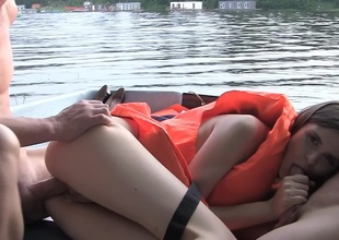 Hardcore atop a boat with a cutie relative to a life vest