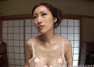 Arousing Japanese mature mollycoddle Julia gives a foot job and tit fuck